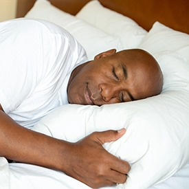 Man sleeping deeply in bed